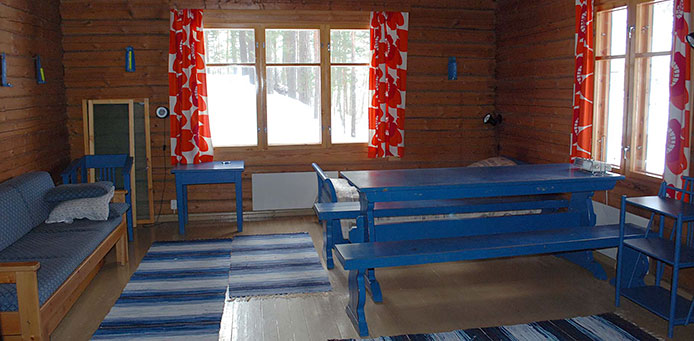 Blue wooden furniture and a sofa in the hut.