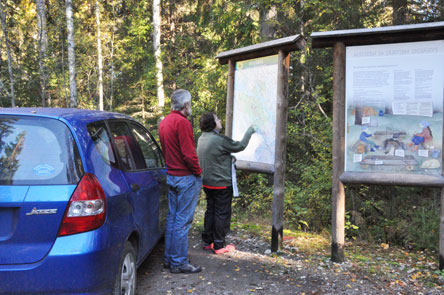 Studying an information board. Photo: Pertti Heinonen