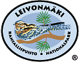 The drawn emblem of Leivonmäki national park. A European nightjar sitting on a branch is depicted inside the oval symbol. The text Leivonmäki - kansallispuisto - national park wraps around the outer edge of the emblem.