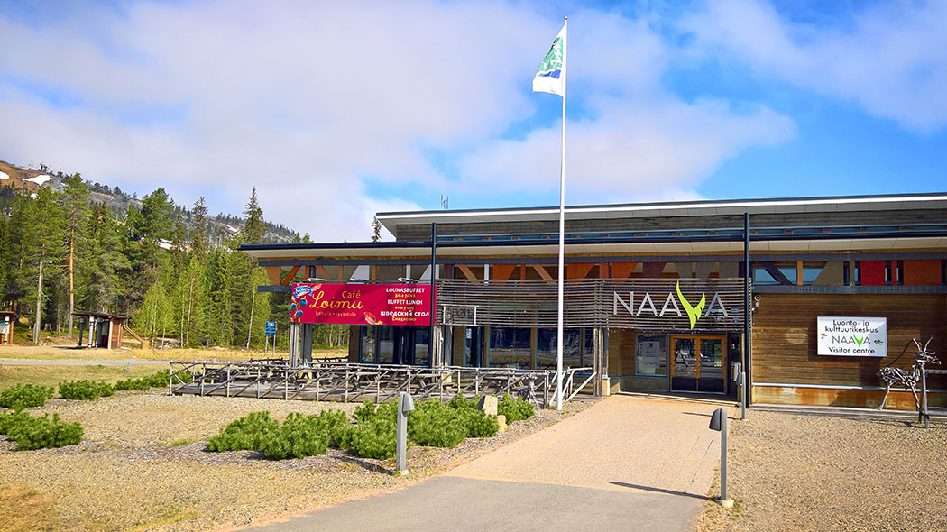 The nature centre building with forest in the background.
