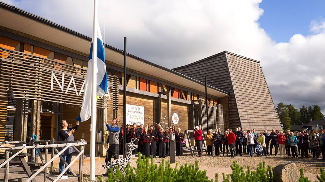 The flag is being raised at the nature day when Finland turned 100 years. Image: Anna Pakkanen