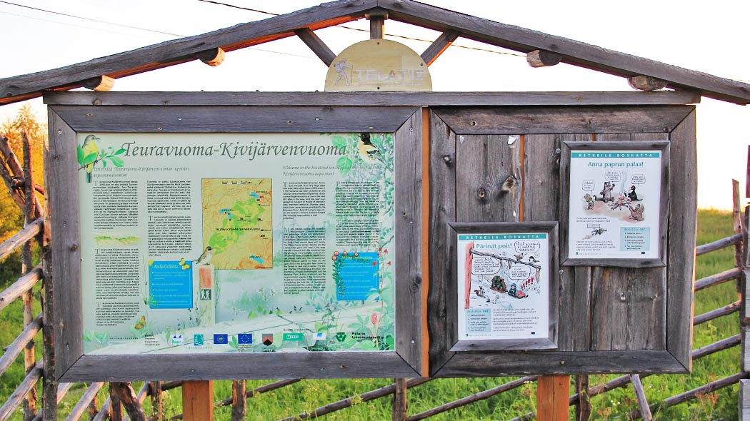 Instructions on exploring Teuravuoma - Kivijärvenvuoma protected mire area in the beginning of the trail in Kurtakko Village. Photo: Maarit Kyöstilä.