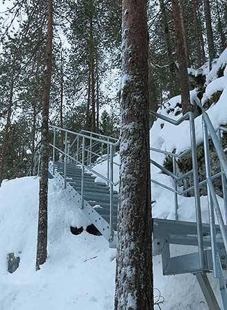 Iron stairs on a slope in winter.
