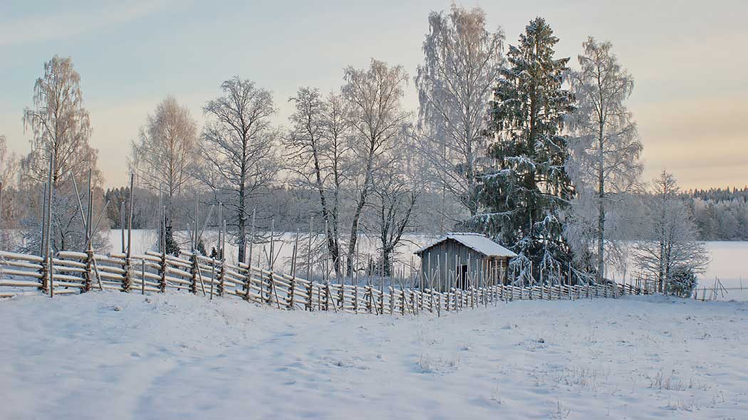 Korteniemi heritage farm landscape draped in snow.