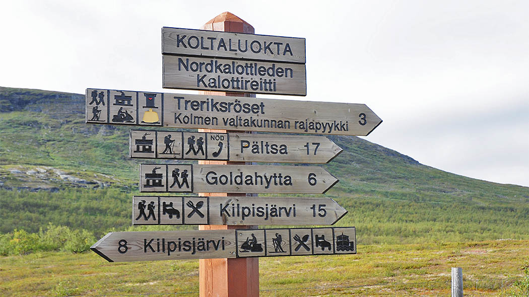 Nordkalottleden Trail signs in Sweden close to the Three Nations Borderpoint. Photo: Seija Olkkonen.