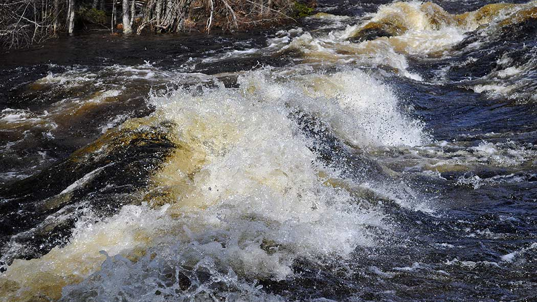 Whitecaps in the flowing rapids.