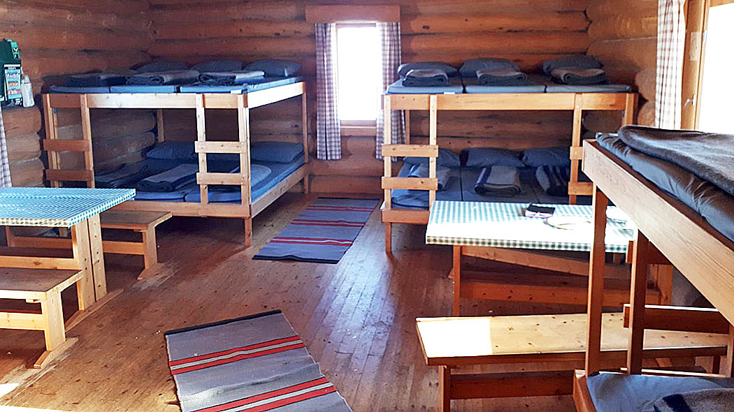 Several sleeping platforms and tables in the hut.